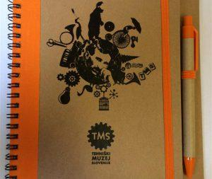 TMS notebook and pen
